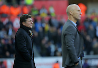 (L-R) Watford manager Walter Mazzarri  and Swansea manager Bob Bradley watch the game from the touch line during the Premier League match between Swansea City and Watford at The Liberty Stadium on October 22, 2016 in Swansea, Wales, UK.
