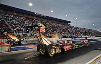 Sept. 16, 2011; Concord, NC, USA: NHRA top fuel dragster driver Terry McMillen (near lane) races alongside Bob Vandergriff Jr during qualifying for the O'Reilly Auto Parts Nationals at zMax Dragway. Mandatory Credit: Mark J. Rebilas-US PRESSWIRE