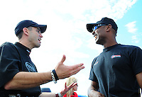 Aug. 19, 2011; Brainerd, MN, USA: NHRA top fuel dragster driver Antron Brown (right) talks with Larry Dixon during qualifying for the Lucas Oil Nationals at Brainerd International Raceway. Mandatory Credit: Mark J. Rebilas-