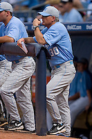 North Carolina Tar Heels head coach Mike Fox #30 watches the action from the top step of the dugout at Durham Bulls Athletic Park May 23, 2009 in Durham, North Carolina. The Tigers defeated the Tar Heals 4-3 in 11 innings.  (Photo by Brian Westerholt / Four Seam Images)