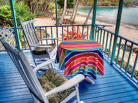 Cottage with table and chairs and ocean view. St. John, Virgin Islands.