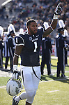 Nevada's Brandon Wimberly participates in pre-game ceremonies before an NCAA college football game against BYU in Reno, Nev., on Saturday, Nov. 30, 2013. (AP Photo/Cathleen Allison)