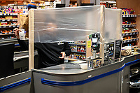 GERMANY, Hamburg, Corona Virus, COVID-19 , supermarket with protection for the cashier to avoid infection