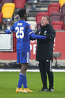 Leicester City Manager, Brendan Rodgers, speaks to Wilfred Ndidi at the end of the match during Brentford vs Leicester City, Emirates FA Cup Football at the Brentford Community Stadium on 24th January 2021