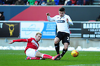 Decland John of Swansea City is tackled by Andreas Weimann of Bristol City during the Sky Bet Championship match between Bristol City and Swansea City at Ashton Gate in Bristol, England, UK. Monday 02 February 2019