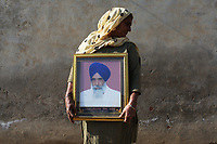 Sukpal Kaur, holds a portrait of her late husband who died as a result of contracting Hepatitis C. It is believed that excessive pesticide use in the region over the past 30-40 years has led to the accumulation of dangerous levels of toxins such as uranium, lead and mercury which are contributing to increased health problems in rural communities. It's a hidden epidemic which is gripping the Punjab region in northeast India which for decades has been the country's 'bread basket'. As local farmers and their families continue to get ill they are paying the price for the country's 'Green Revolution'.