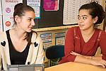Education High School female teacher talking to female student