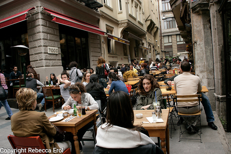 Young people drinking and dining out in a backstreet of Tunel, Istanbul