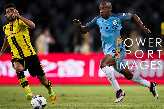 Manchester City midfielder Fabian Delph (r) fights for the ball with Borussia Dortmund midfielder Nuri Sahin (l) during the match against Borussia Dortmund at the 2016 International Champions Cup China match at the Shenzhen Stadium on 28 July 2016 in Shenzhen, China. Photo by Victor Fraile / Power Sport Images