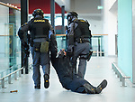 The body of an attacker who was holding a hostage is dragged from the scene in the terminal building by heavily armed Garda personnel during a bilateral training exercise between An Garda Siochana and the Defence Forces hosted at Shannon Airport. Photograph by John Kelly.