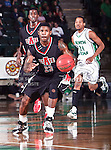 Arkansas State Red Wolves guard Donald Boone (23) drives the ball down court during the NCAA  basketball game between the Arkansas State Red Wolves and the University of North Texas Mean Green at the North Texas Coliseum,the Super Pit, in Denton, Texas. UNT defeated Arkansas State 83 to 64..