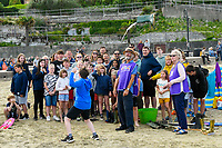 BNPS.co.uk (01202 558833)<br /> Pic: Graham Hunt/BNPS<br /> <br /> With the Olympics coming to an end holidaymakers and Lyme Regis locals made their fun in the form of competitive 'Welly Wanging'.<br /> <br /> Holidaymakers and locals compete in the under 12's section of the Welly Wanging competition on the beach at the seaside resort of Lyme Regis in Dorset during the towns Regatta and Carnival Week.<br /> <br /> The aim of the Welly Wanging is to throw a boot full of water over your head as far as possible with each competitor getting three attempts.