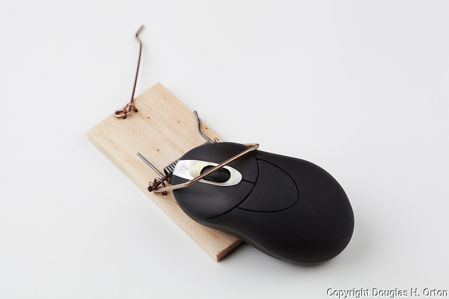 Mouse trap(s).  Generic mouse traps in clean cut, white background with computer mouse caught.