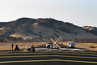 Contractors for the Lampson Field airport (102) resurfacing project complete painting the threshold markings, Lakeport, Lake County, California