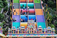 Stairs Leading to Batu Caves, Hindu Deities in foreground, Selangor, Malaysia.