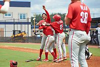 GCL Phillies East Jose Cedeno (back), Jose Tortolero (33), and Wilfredo Flores (2) celebrate after a walk off sacrifice fly during a Gulf Coast League game against the GCL Yankees East on July 31, 2019 at Yankees Minor League Complex in Tampa, Florida.  GCL Phillies East defeated the GCL Yankees East 4-3 in the second game of a doubleheader.  (Mike Janes/Four Seam Images)