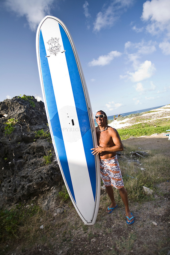 Local windsurfer, surfer, SUPer, Brian Talma, Stand-Up Paddling on Silver Rock Beach, outside of his watersports shop, De Action.Silver Rock, Christ Church Parish.Barbados