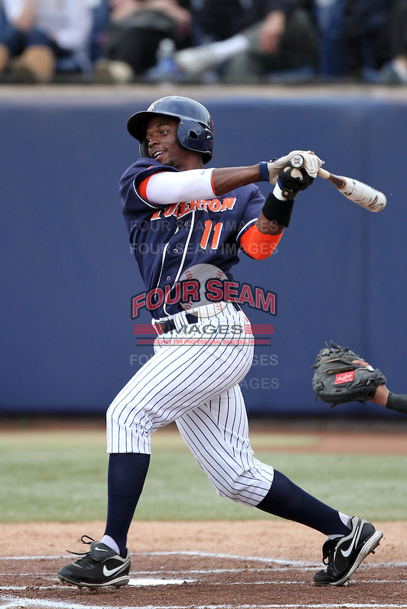 Ivory Thomas #11 of the Cal. St. Fullerton Titans bats against the Cal. St. Long Beach 49'ers at Goodwin Field in Fullerton,California on May 14, 2011. Photo by Larry Goren/Four Seam Images