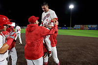 Auburn Doubledays Jake Alu (9) celebrates with teammates after a walk off single during a NY-Penn League game against the Mahoning Valley Scrappers on August 27, 2019 at Falcon Park in Auburn, New York.  Auburn defeated Mahoning Valley 3-2 in ten innings.  (Mike Janes/Four Seam Images)