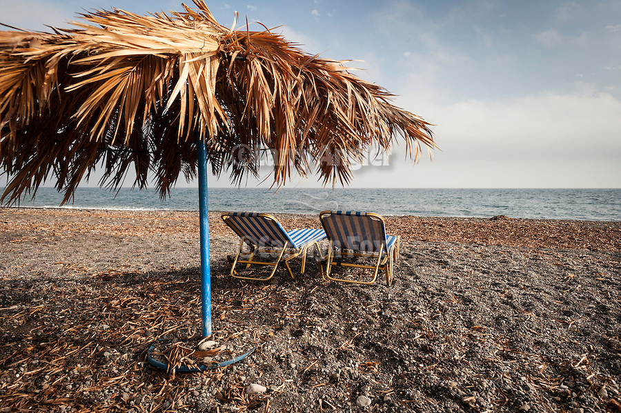 Cabanas and chase lounges on the beach, Exo Gialos, Santorini, Greece