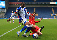17th October 2020; Ewood Park, Blackburn, Lancashire, England; English Football League Championship Football, Blackburn Rovers versus Nottingham Forest ; Ryan Nyambe of Blackburn Rovers is tackled by Tobias Figueiredo of Nottingham Forest