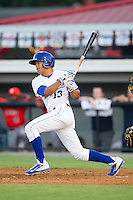 Angelo Castellanos (13) of the Burlington Royals follows through on his swing against the Greeneville Astros at Burlington Athletic Park on June 30, 2014 in Burlington, North Carolina.  The Royals defeated the Astros 9-8. (Brian Westerholt/Four Seam Images)