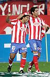 Atletio de Madrid's Raul Garcia and Kun Aguero celebrate during La Liga match. May 30, 2009. (ALTERPHOTOS/Alvaro Hernandez)