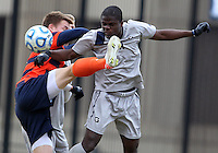 WASHINGTON, DC - NOVEMBER 25, 2012: Melvin Snoh (21) of Georgetown University nods the ball away from Jordan Vale (2) of Syracuse University during an NCAA championship third round match at North Kehoe field, in Georgetown, Washington DC on November 25. Georgetown won 2-1 after overtime and penalty kicks.