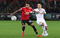 Roque Mesa of Swansea City challenges Jesse Lingard of Manchester United during the Carabao Cup Fourth Round match between Swansea City and Manchester United at the Liberty Stadium, Swansea, Wales, UK. Tuesday 24 October 2017