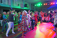 BNPS.co.uk (01202 558833)<br /> Pic: ElvisPresleyFanClubOfGB/BNPS<br /> <br /> Pictured: Fan club members at the Annual Elvis Week event near Great Yarmouth, Norfolk, in 2019, held every year.<br /> <br /> One of the world's most renowned Elvis Presley fan clubs is expected to sell for a staggering £100,000.<br /> <br /> The Official Elvis Presley Fan Club of Great Britain was established in London in 1957 and has a membership of almost 5,000 people over 60 years on.<br /> <br /> The current president, Todd Slaughter, bought it in 1967 after working as a journalist on music magazines.