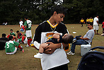 IMMIGRANTS4.DN.091105.EDR.JPG  Wilmer Chavez, 14, cradles his 2-month-old brother Gerardo Islas during halftime of their father's Liga Latina de Warsaw soccer match behind Warsaw Elementary School on Sunday, Sept. 11, 2005.  staff/Ted Richardson.