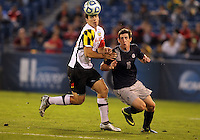 HOOVER, AL - DECEMBER 07, 2012:  Jake Pace (20) of the University of Maryland pushes past Jimmy Nealis (16) of Georgetown University during an NCAA 2012 Men's College Cup semi-final match, at Regions Park, in Hoover , AL, on Friday, December 07, 2012. The game ended in a 4-4 tie, Georgetown won on penalty kicks after overtime.