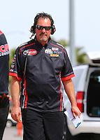 Apr 10, 2015; Las Vegas, NV, USA; Crew member for NHRA top fuel driver J.R. Todd during qualifying for the Summitracing.com Nationals at The Strip at Las Vegas Motor Speedway. Mandatory Credit: Mark J. Rebilas-