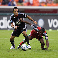 Dwayne De Rosario (7) of D.C. United steps away from the tackle of Doneil Henry (4) of Toronto FC during the game at RFK Stadium in Washington, DC.  D.C. United tied Toronto FC, 3-3.