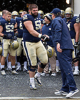 Pitt head coach Paul Chryst and senior offensive lineman Zenel Demhasaj. The Pitt Panthers defeat the Rutgers Scarlet Knights 27-6 on Saturday, November 24, 2012 at Heinz Field , Pittsburgh, PA.