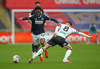 3rd October 2020; Liberty Stadium, Swansea, Glamorgan, Wales; English Football League Championship, Swansea City versus Millwall; Mahlon Romeo of Millwall evades the challenge from Matt Grimes of Swansea City