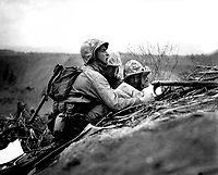 Observer who spotted a machine gun nest finds its location on a map so they can send the information to artillery or mortars to wipe out the position.  Iwo Jima, February 1945.  Dreyfuss.  (Marine Corps)<br /> Exact Date Shot Unknown<br /> NARA FILE #:  127-N-109619<br /> WAR & CONFLICT BOOK #:  1218