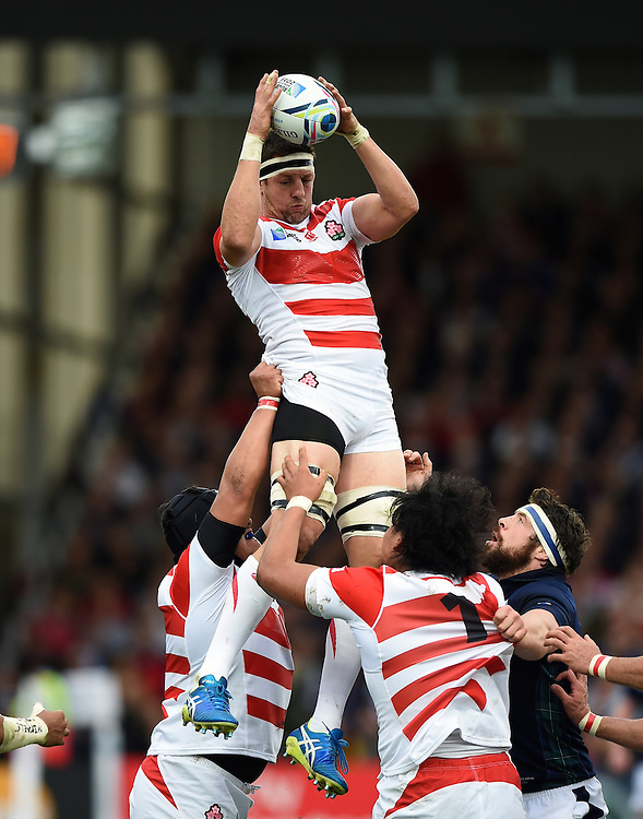 Luke Thompson of Japan wins the ball at a lineout. Rugby World Cup Pool B match between Scotland and Japan on September 23, 2015 at Kingsholm Stadium in Gloucester, England. Photo by: Patrick Khachfe / Stewart Communications