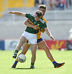 Dan McCarthy of Kerry in action against Adam O'Connor of Clare during their Munster Minor football final at Pairc Ui Chaoimh. Photograph by John Kelly.