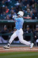 Brandon Riley (1) of the North Carolina Tar Heels follows through on his swing against the Charlotte 49ers at BB&T BallPark on March 27, 2018 in Charlotte, North Carolina. The Tar Heels defeated the 49ers 14-2. (Brian Westerholt/Four Seam Images)