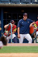 Toledo Mud Hens manager Doug Mientkiewicz (left) and hitting coach Mike Hessman (right) during an International League game against the Durham Bulls on July 16, 2019 at Fifth Third Field in Toledo, Ohio.  Durham defeated Toledo 7-1.  (Mike Janes/Four Seam Images)