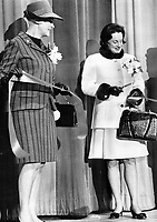 Mrs. John Robarts, wife of the premier of Ontario, cuts the ribbon to offcially open the Women's World five-day exhibition at the Queen Elizabeth Building at Exhibition Park. Mrs. Robarts (right) arrived by helicopter.<br /> <br /> Photo : Boris Spremo - Toronto Star archives - AQP