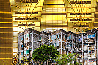 Construction of the iconic Grand Lisboa casino taken in 2006, with workers on bamboo scaffolding, adjusting the modern, golden windows, in Macao China
