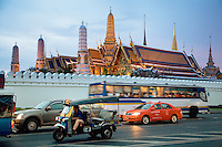 Thailand. Bangkok. Grand Palace. The Grand Palace was established in 1782 and it houses not only the royal residence and throne halls but also a number of government offices. Traffic congestion. Buses, cars, taxis and tuk-tuk on Na Phra Lan Road. An auto rickshaw or three-wheelers (tuk-tuk, auto, rick, autorick or rickshaw) is a motor vehicle that is one of the chief modes of transport, especially as a vehicle for hire. It is a small three-wheeled cart driven by a person, and is related to the cabin cycle. Tha Tian's community is located in the downtown area and in the center of the urban historic district, called Koh Rattanakosin. Tha Thian is surrounded by a major heritage and tourist site, The Grand Palace. 27.03.09 © 2009 Didier Ruef
