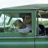 Saskia, Lady Manners at the wheel of a Landrover on the Haddon estate