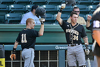 Shortstop Derek Hirsch (11) of the Wofford Terriers scores a run in a SoCon Tournament game against Western Carolina on Wednesday, May 25, 2016, at Fluor Field at the West End in Greenville, South Carolina. Western won, 10-9. (Tom Priddy/Four Seam Images)