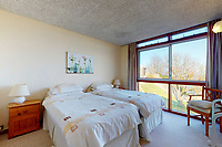 BNPS.co.uk (01202) 558833. <br /> Pic: Albury&Hall/BNPS<br /> <br /> Pictured: Bedroom. <br /> <br /> A unique 'grand design' cliff-top home that has dramatic sea views has gone on the market for £2m.<br /> <br /> The three storey six-bedroom property was designed in the 1960s by architect John Morgan for him to live in.<br /> <br /> At the time the flat-roofed building with floor to ceiling windows was considered a revolutionary design.<br /> <br /> The property's stunning location on the cliffs above Swanage in Dorset provide uninterrupted sea views of Poole Bay and across to The Needles on the Isle of Wight.