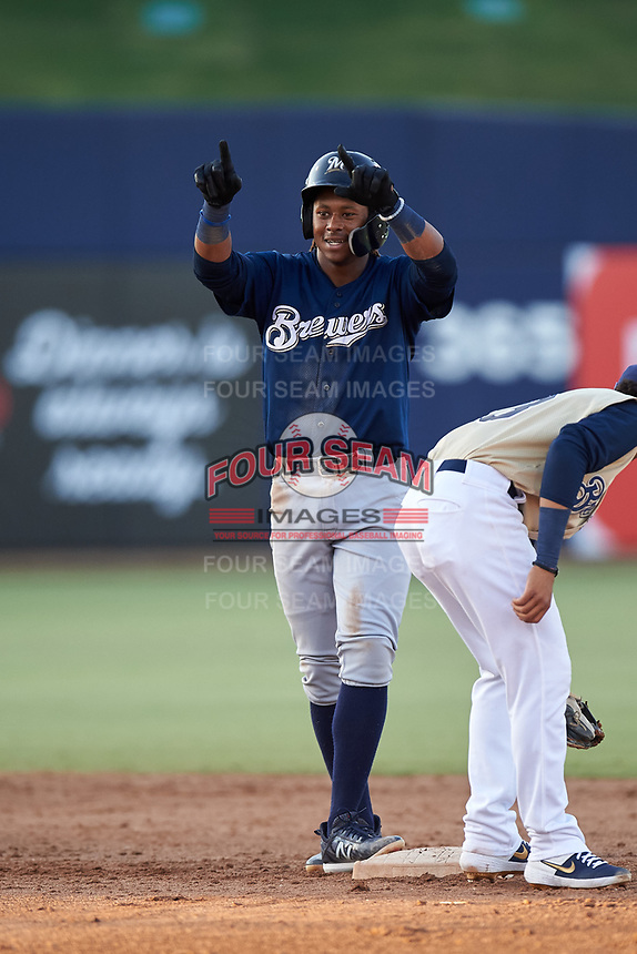 AZL Brewers Blue Orveo Saint (30) celebrates after hitting a double during an Arizona League game against the AZL Brewers Gold on July 13, 2019 at American Family Fields of Phoenix in Phoenix, Arizona. The AZL Brewers Blue defeated the AZL Brewers Gold 6-0. (Zachary Lucy/Four Seam Images)