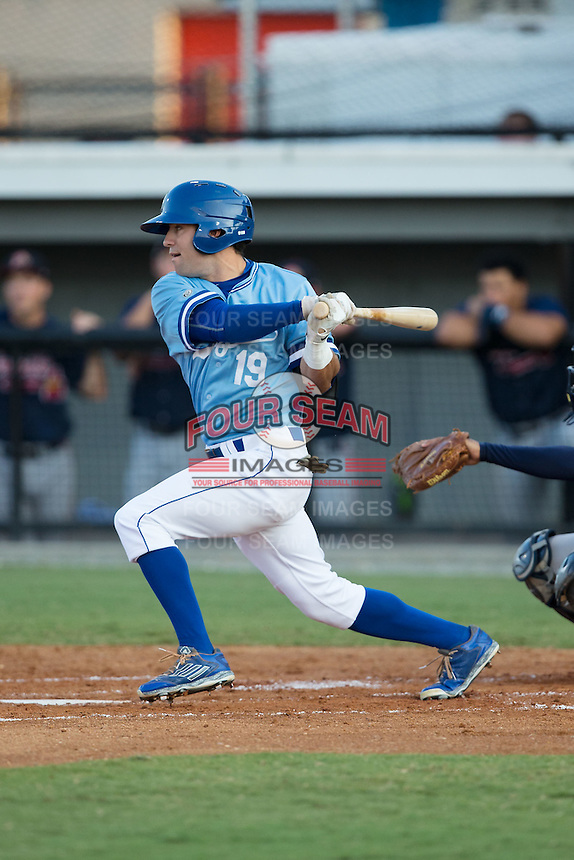 Luke Willis (19) of the Burlington Royals follows through on his swing against the Danville Braves at Burlington Athletic Park on August 13, 2015 in Burlington, North Carolina.  The Braves defeated the Royals 6-3. (Brian Westerholt/Four Seam Images)