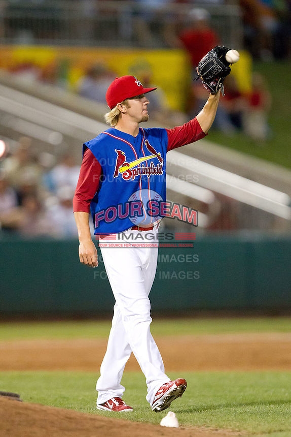 Jordan Swagerty (18) of the Springfield Cardinals catches a ball thrown to the mound during a game against the Corpus Christi Hooks at Hammons Field on August 13, 2011 in Springfield, Missouri. Springfield defeated Corpus Christi 8-7. (David Welker / Four Seam Images)
